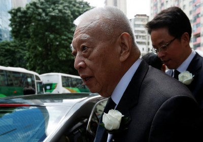 Former Hong Kong Chief Executive Tung Chee-hwa (L) and Zhang Xiaoming, Director of China's Liaison Office in Hong Kong, leave after attending the funeral of Cheng Yu-tung, founder of Hong Kong property group New World Development, in Hong Kong, China October 13, 2016.  REUTERS/Bobby Yip