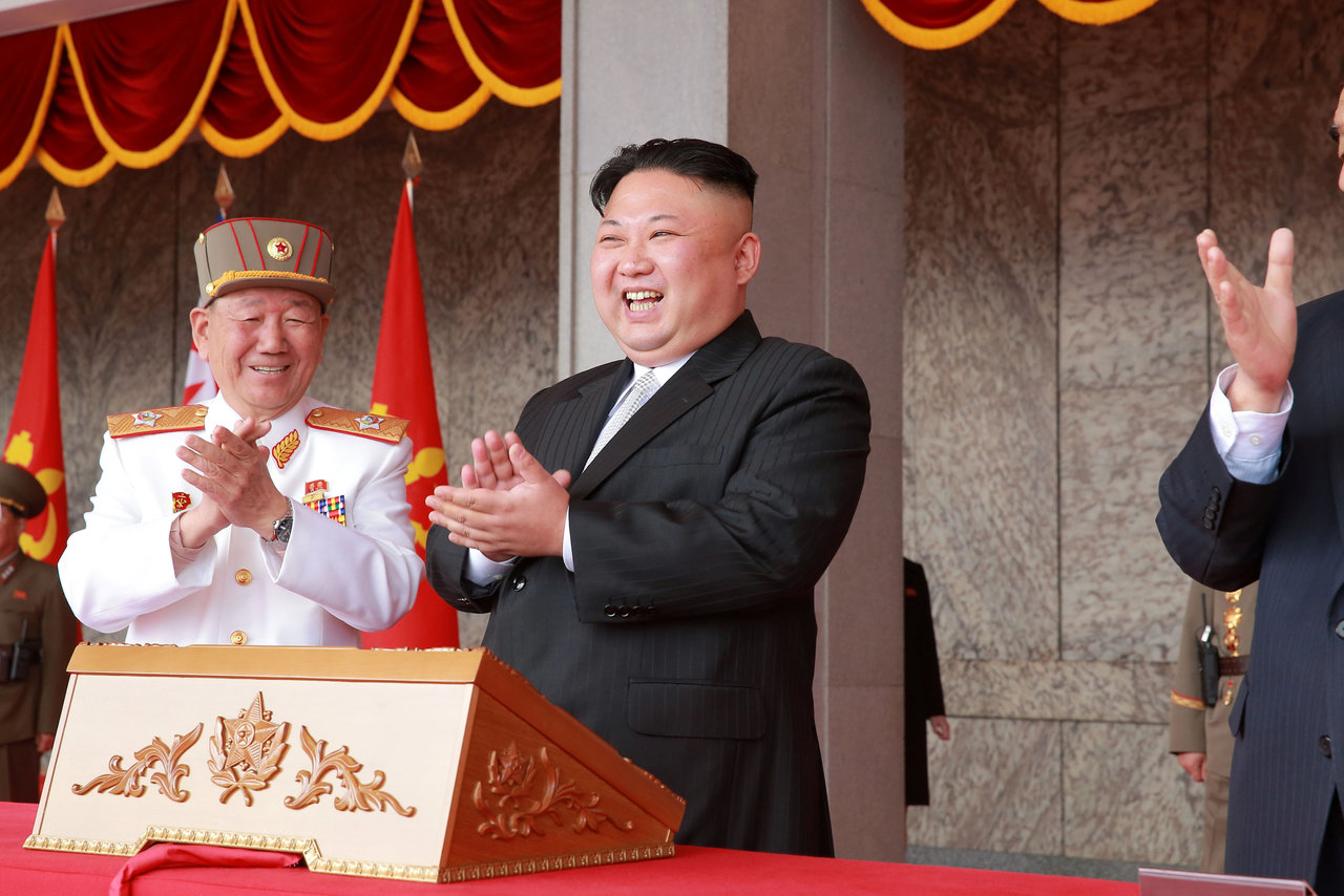 North Korean leader Kim Jong Un applauds during a military parade and a public procession of Pyongyang citizens celebrating the 105th birth anniversary of founder Kim Il Sung in this photo released by KCNA