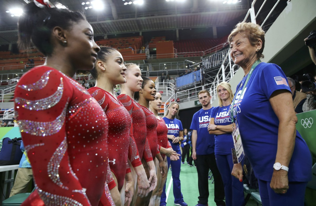 2016 Rio Olympics - Gymnastics training - Rio Olympic Arena - Rio de Janeiro, Brazil - 04/08/2016. (From L) Simone Biles (USA) of USA, Laurie Hernandez (USA) of USA, Madison Kocian (USA) of USA, Gabrielle Douglas (USA) of USA (Gabby Douglas) and Alexandra Raisman (USA) of USA (Aly Raisman) speak to team coordinator Martha Karolyi (R) during training. REUTERS/Damir Sagolj FOR EDITORIAL USE ONLY. NOT FOR SALE FOR MARKETING OR ADVERTISING CAMPAIGNS.