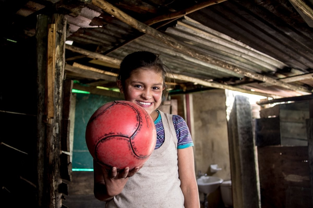 in-a-colombian-home-living-on-123month-per-adult-the-favorite-toy-is-a-soccer-ball