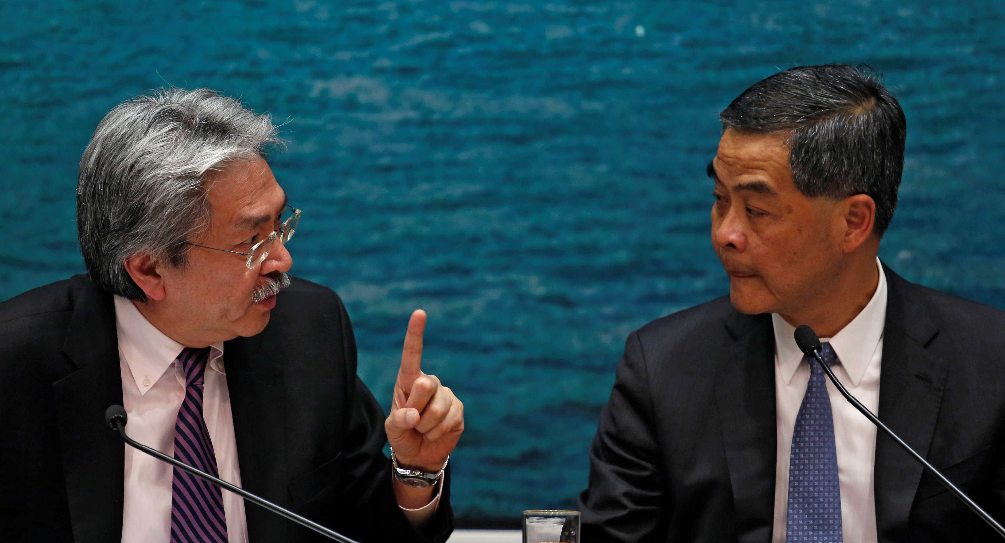 Hong Kong Chief Executive Leung Chun-ying listens to Financial Secretary John Tsang during a news conference in Hong Kong, China November 4, 2016. REUTERS/Bobby Yip