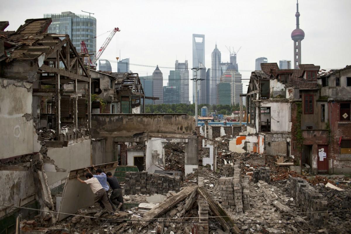 農村地權分拆之下,城鄉地價懸殊,拉闊貧富差距。 圖片來源:路透社