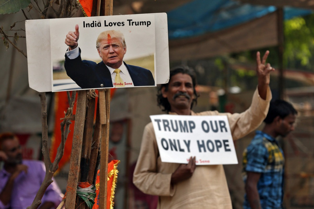 A member of Hindu Sena, a right-wing Hindu group, celebrate Republican presidential nominee Donald Trump's victory in the U.S. elections, in New Delhi, India, November 9, 2016. REUTERS/Cathal McNaughton