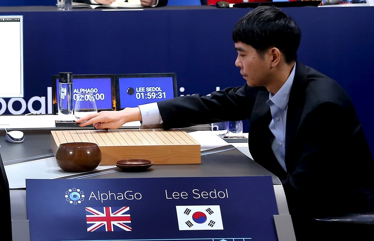 The world's top Go player Lee Sedol puts the first stone against Google's artificial intelligence program AlphaGo
