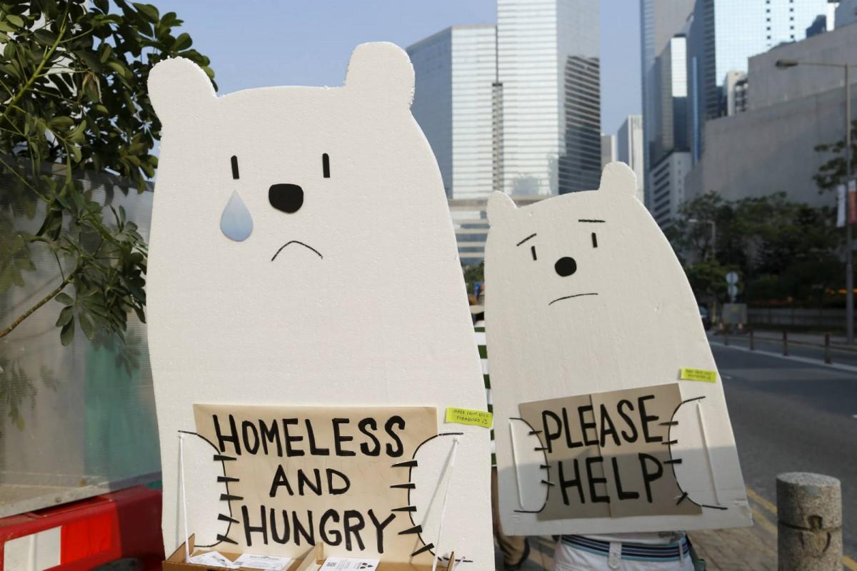 2015 年 11 月 29 日香港氣候大遊行中有示威者扮成北極熊。 圖片來源:路透社