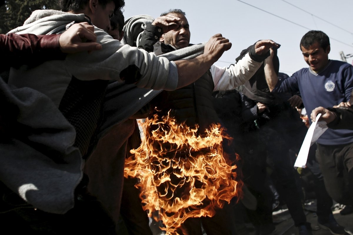 a-refugee-sets-himself-on-fire-during-a-protest-near-the-village-of-idomeni-greece-demanding-the-greek-macedonian-border-be-opened