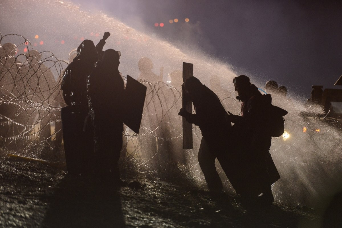 police-use-a-water-cannon-on-protesters