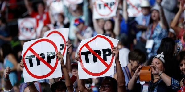 全球化貿易傷害基層,反貿易一樣傷害基層。 圖片來源:路透社
