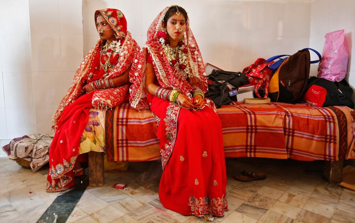 sixteen-embellishments-in-addition-to-a-lucky-red-sari-or-skirt-like-lehenga-adorn-the-indian-bride