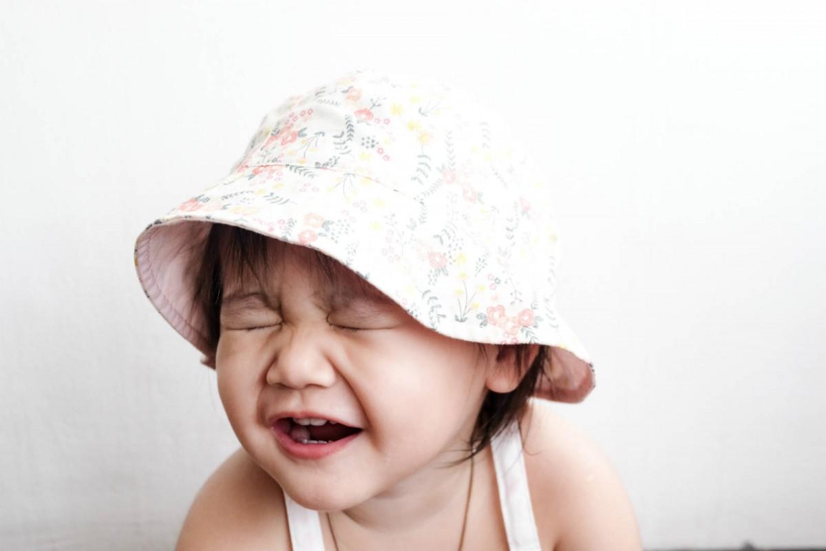 她在哭還是笑,看得出來嗎?